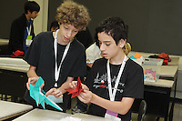 Nathan Zimet, Vermont, USA, teaches his complex origami model Fox to Omri Shavit at OrigamiUSA 2013.