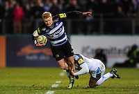 Tom Homer of Bath Rugby is tackled by Chris Harris of Newcastle Falcons. Aviva Premiership match, between Bath Rugby and Newcastle Falcons on March 18, 2016 at the Recreation Ground in Bath, England. Photo by: Patrick Khachfe / Onside Images