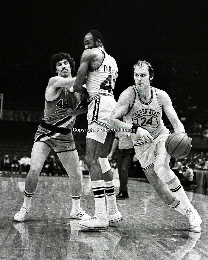 Golden State Warriors Rick Barry drives for the hoop with help from a screen by center Nate Thurmond..1973 photo/Ron Riesterer