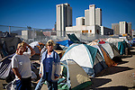 RENO, NV - OCTOBER 6:  Mary Jackson, left, and Marian Schamp live in a tent city for the homeless in downtown Reno, Nevada October 6, 2008. The City of Reno set up the tent city when existing shelters became overcrowded as Nevada struggles with one of the highest unemployment rates in the country. (Photo by Max Whittaker/Getty Images)