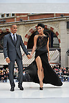 Nicole Scherzinger  &  boyfriend Lewis Hamilton arrive at premiere of Men In Black 3 in the daring dress she wore to  premiere of Men In Black 3..The former Pussycat Dolls singer opted for an eye-catching black Cengiz Abazoglu dress which had a very long thigh-high split as she posed up for photographers at the event in London's Leicester Square..© Antony Jones