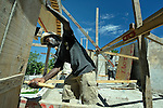 A worker helps construct a new school in the Puits Blain neighborhood of Port-au-Prince, Haiti. The construction is supported by the United Methodist Committee on Relief (UMCOR) and Volunteers in Mission, as part of their work in Haiti after the 2010 earthquake..