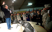Kandahar, Afghanistan - December 17, 2008 -- Comedian Lewis Black entertains the troops stationed at Kandahar, Afghanistan during the  2008 USO Holiday Tour. Tour host United States Navy Admiral Mike Mullen, chairman of the Joint Chiefs of Staff, along with his wife Deborah welcomed comedians John Bowman and Kathleen Madigan; actress Tichina Arnold; American Idol contestant and country musician Kellie Pickler and Grammy award winning musician Kid Rock on the tour bringing music and entertainment to service members and their families stationed overseas..Credit: Chad J. McNeeley - DoD via CNP