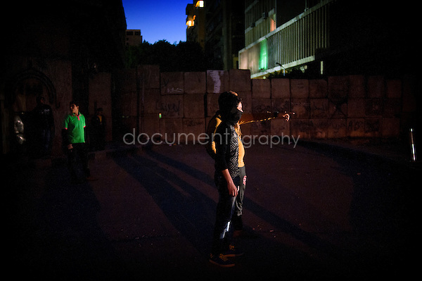 Copyright : Magali Corouge / Documentography.Cairo, the 30th of January 2013.Clashes in front of the hotel Semaris at the corniche, in Cairo.