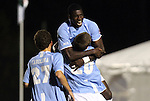 10 November 2010: UNC's Martin Murphy (20) celebrates his goal with Jalil Anibaba (behind) and Matt Rose (27). The University of North Carolina Tar Heels the North Carolina State University Wolfpack at Koka Booth Stadium at WakeMed Soccer Park in Cary, North Carolina in an ACC Men's Soccer Tournament Quarterfinal game.