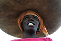 African woman carrying vegetables on her head, Kigali, Rwanda