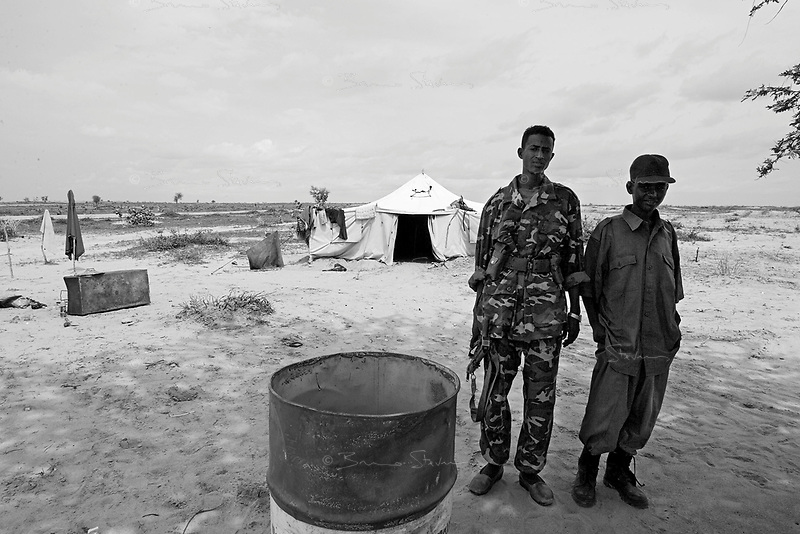 En Geneina, West Darfur, August 8, 2004.Janjaweed outpost near the city. Mustapha Ahmad (Left) and Moussa Ahmad, 15, (Right).