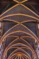 Low angle view of rib vault ceiling of the nave of the upper chapel of La Sainte-Chapelle (The Holy Chapel), 1248, Paris, France. La Sainte-Chapelle was commissioned by King Louis IX to house his collection of Passion Relics, including the Crown of Thorns. The Sainte-Chapelle is considered among the highest achievements of the Rayonnant period of Gothic architecture. Picture by Manuel Cohen