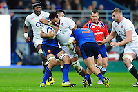 Billy Vunipola of England takes on the France defence. RBS Six Nations match between France and England on March 19, 2016 at the Stade de France in Paris, France. Photo by: Patrick Khachfe / Onside Images