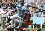 09 September 2006: North Carolina's Barrington Edwards (32) is tripped up by Virginia Tech's Branden Ore (below) while being chased by Justin Harper (81) after recovering a fumble. The University of North Carolina Tarheels lost 35-10 to the Virginia Tech Hokies at Kenan Stadium in Chapel Hill, North Carolina in an Atlantic Coast Conference NCAA Division I College Football game.