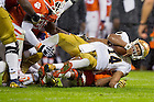 Oct. 3, 2015; Irish quarterback DeShone Kizer (14) is tackled in the second quarter at Clemson. (Photo by Matt Cashore)
