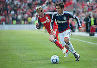 02 April 2011: Chivas USA forward Marcos Mondaini #23 and Toronto FC midfielder Jacob Peterson #23 in action during an MLS game between Chivas USA and the Toronto FC at BMO Field in Toronto, Ontario Canada..The game ended in a 1-1 draw.
