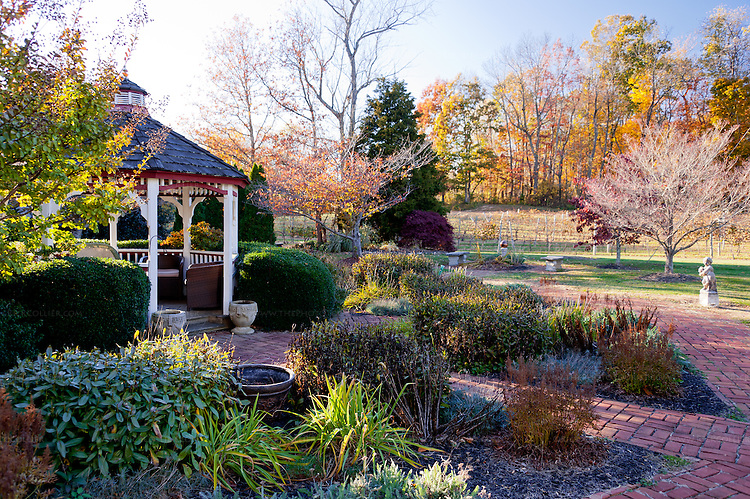 A gazebo nestled in gardens offers a quiet and attractive place for a glass of wine, in the side yard at Gray Ghost Vineyards.