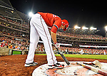 19 May 2012: Washington Nationals infielder Stephen Lombardozzi preps his bat in the on-deck circle during game action against the Baltimore Orioles at Nationals Park in Washington, DC. The Orioles defeated the Nationals 6-5 in the second game of their 3-game series. Mandatory Credit: Ed Wolfstein Photo