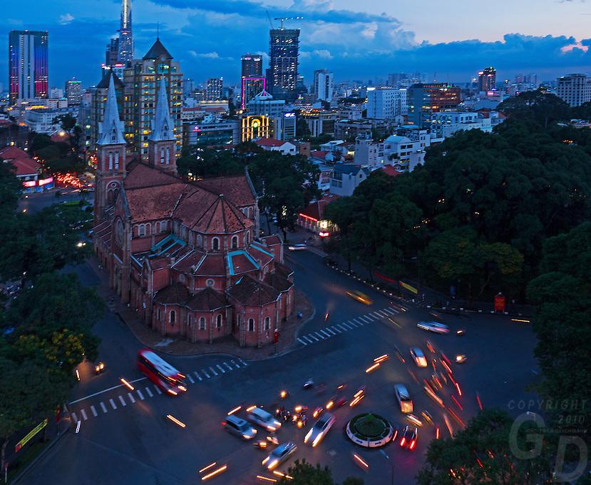 An Birds Eye View of Saigon (Ho Chi Minh City, HCMC) and the stunning Notre-Dame Cathedral Basilica of Saigon (Vietnamese: Vương cung thánh đường Chính tòa Đức Bà Sài Gòn or Nhà thờ Đức Bà Sài Gòn; French: Basilique-Cathédrale Notre-Dame de Saigon),  is a cathedral located in the downtown of Ho Chi Minh City, Vietnam. Established by French colonists who initially named it Cathédrale Notre-Dame de Saïgon, the cathedral was constructed between 1863 and 1880. It has two bell towers, reaching a height of 58 meters (190feet).