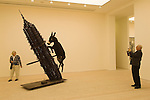 The Saatchi Gallery. The Duke of York Headquarters, Chelsea, London UK 2008. The Revolution Continues: New Art from China. Donkey by Zhang Huan. Through dog is p[ainting of Portraitt of Mao by Qiu Jie.