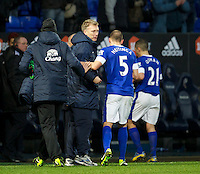 BOLTON, ENGLAND - Saturday, January 26, 2013: Everton's manager David Moyes with match-winning substitute John Heitinga who's late goal sealed a 2-1 victory over Bolton Wanderers during the FA Cup 4th Round match at the Reebok Stadium. (Pic by David Rawcliffe/Propaganda)