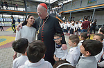 Cardinal Timothy Dolan, the archbishop of New York, embraces Dominican Sister Muntahah Haday at the Al Bishara School run by the Dominican Sisters of St. Catherine of Siena in Ankawa, near Erbil, Iraq, on April 9, 2016. Dolan, chair of the Catholic Near East Welfare Association, is in Iraqi Kurdistan with other church leaders to visit with Christians and others displaced by ISIS. The Dominican Sisters were themselves displaced by ISIS, and have established schools and other ministries among the displaced.<br /> <br /> CNEWA is a papal agency providing humanitarian and pastoral support to the church and people in the region.