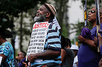 A man attend a rally for the first anniversary of the death of Eric Garner in Brooklyn New York 07/18/2015. Kena Betancur/VIEWpress