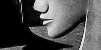 Detail view of sculptured face at entrance to Matakana public toilets. Designed by Steffan de Haan. Matakana, North Auckland.
