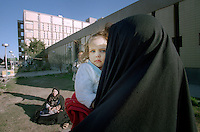 (February 1998)    A girl and her mother outside t the Saddam hospital in Baghdad.    <br /> Due to UN sanctions the hospital was lacking many medicines, and the civilians suffered due to lack of food as well. <br />  Former U.N. Humanitarian Coordinator in Iraq Denis Halliday estimated the resulting deaths : &quot;Two hundred thirty-nine thousand children 5 years old and under&quot; as of 1998.<br /> <br /> The sanctions against Iraq were a near-total financial and trade embargo imposed by the United Nations Security Council on the Iraqi Republic.<br /> <br /> <br /> &copy;Fredrik Naumann/Felix Features