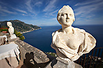 Photo of old statues in Ravello, Italy with the Amalfi coast in the background.