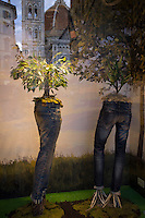 Il Duomo di Firenze reflected in shop window of Energie shop featuring denim jeans in Piazza Dell Olio in Florence,Tuscany, Italy