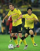 Fussball Bundesliga Saison 2011/2012 1. Spieltag Borussia Dortmund - Hamburger SV V.l.: Kevin GROSSKREUTZ (BVB), Shinji KAGAWA (BVB).