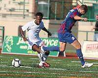 Andrew Marshall #5 of Crystal Palace Baltimore loses the ball to Gregory Richardson #20 of the Carolina Railhawks during an NASL match at Paul Angelo Russo Stadium in Towson, Maryland on September 18 2010.