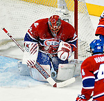 26 October 2009: Montreal Canadiens' goaltender Jaroslav Halak makes a third period save against the New York Islanders at the Bell Centre in Montreal, Quebec, Canada. The Canadiens defeated the Islanders 3-2 in sudden death overtime for their 4th consecutive win. Mandatory Credit: Ed Wolfstein Photo