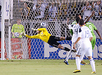 Seattle Sounders goalie Kasey Keller (18) tries to block LA Galaxy defender Omar Gonzalez's goal during the first half of the game between LA Galaxy and the Seattle Sounders at the Home Depot Center in Carson, CA, on November 7, 2010. LA Galaxy 2, Seattle Sounders 1. LA Galaxy advance in the playoffs with an aggregate score of 3 to 1.