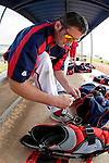 25 February 2007: Washington Nationals catcher Brian Schneider laces up his shoe during batting practice at their spring training facility in Viera, Florida.<br /> <br /> Mandatory Photo Credit: Ed Wolfstein Photo