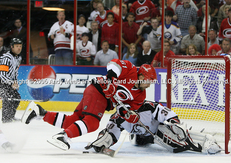 22 May 2006: Buffalo's Ryan Miller (30) stops Carolina's Cory Stillman (61) on a breakaway in the second period. The Carolina Hurricanes defeated the Buffalo Sabres 4-3 at the RBC Center in Raleigh, North Carolina in the second game of their best of seven National Hockey League Eastern Conference Finals playoff series. The series is tied one game apiece.