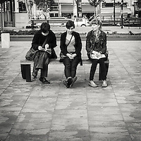 Three women sitting on a bench looking confused over whaer to go next on a visit to Budapest Hungary