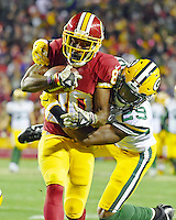 Washington Redskins wide receiver Jamison Crowder (80) is tackled by Green Bay Packers defensive back Kentrell Brice (29) after a 53 yard catch and run late in the fourth quarter at FedEx Field in Landover, Maryland on Sunday, November 20, 2016.  The Redskins won the game 42 - 24.<br /> Credit: Ron Sachs / CNP /MediaPunch