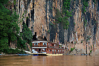 Pak Ou caves overlooking the Mekong River 25 km from Luang Prabang, Laos. They are a group of caves on the left side of the Mekong river, about two hours boat ride upstream from the centre of Luang Prabang