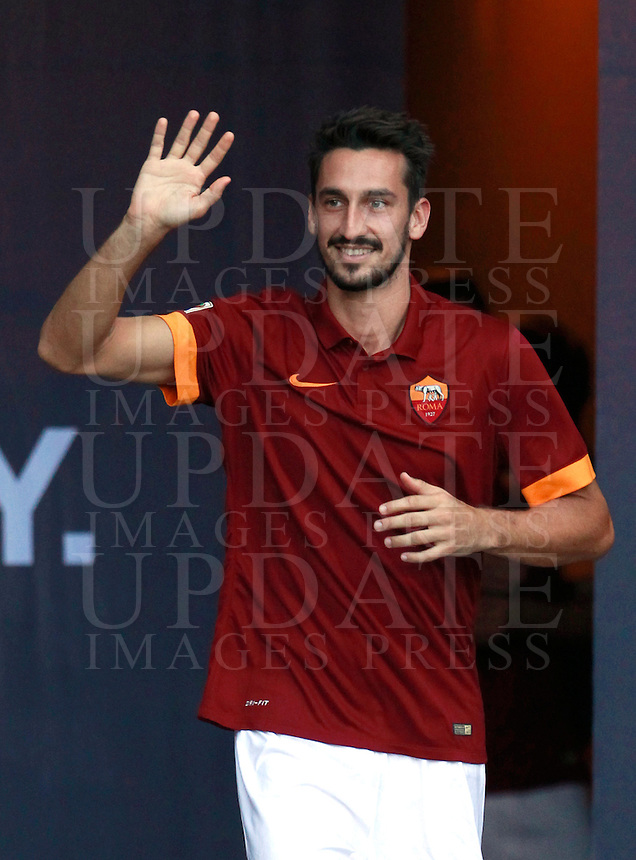 Calcio, amichevole Roma vs Fenerbahce. Roma, stadio Olimpico, 19 agosto 2014.<br /> Roma defender Davide Astori waves to fans as he arrives for the team's presentation, prior to the friendly match between AS Roma and Fenerbahce at Rome's Olympic stadium, 19 August 2014.<br /> UPDATE IMAGES PRESS/Isabella Bonotto