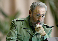 "Cuban President Fidel Castro, gestures while talk in the act of ""Anniversary 30 of the Cuban Armed Intervention in Angola"", Friday, December 2, 2005 in Havana, Cuba Between 1975 and 1988, approximately 350,000 Cubans participated in the war of Angola, on the 22nd of December of 1988 signed the peace accords between Cuba, Angola and South Africa, with the mediation of the United States.  Credit: Jorge Rey/MediaPunch"