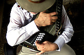 Vance Archer of Asbury Park, NJ plays his auto harp prior to the fiddle competition at the Howell Living Farm in Hopewell Twp. on Saturday August 24, 2002.  photo by jane therese