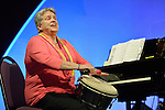 Sally Morris plays a drum during an April 27, 2014, worship service at the United Methodist Women's Assembly in the Kentucky International Convention Center in Louisville, Kentucky. Morris is director of music at Parkway Presbyterian Church and chapel musician at Wake Forest University School of Divinity in Winston-Salem, North Carolina.
