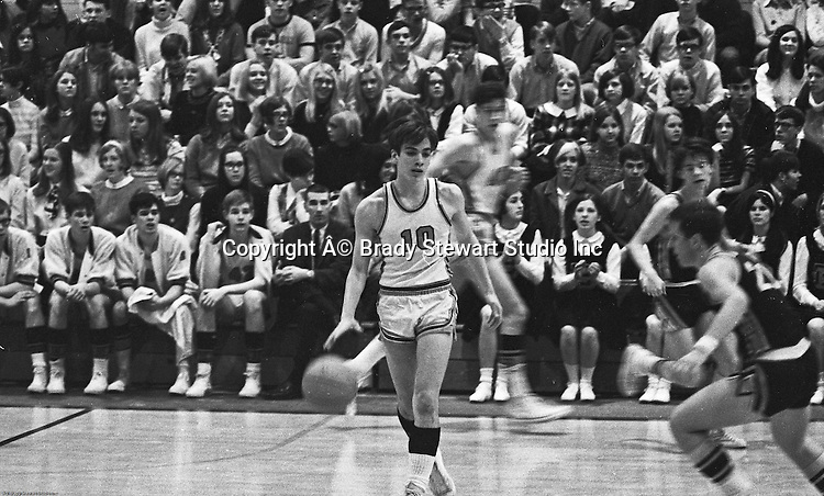 Bethel Park PA:  Mike Stewart 10 dribbling up the court during a basketball game against the Mt Lebanon Blue Devils at Bethel Park Gymnasium - 1968. The JV Team was coached by Mr. Reno and the Bethel Park JVs won the Section Championship.  The team included; Scott Streiner, Steve Zemba, John Klein, Mike Stewart, Bruce Evanovich, Jeff Blosel and Tim Sullivan. Others in the stands; Sue Henney, Glenn Eisaman, John Uhl, Paul Waigand, Celeste Hauck, Janet Lynch, Frank Felicetti, Cathy Clark.