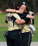 WATERBURY,  CT-051117JS07- WCA's Vanessa Santiago (8), right, gives a hug to teammate Arianna Torres  (7) after Torres read a speech during the first ever Senior Day celebration for the WCA softball team prior to their game against Crosby Thursday at Huntingdon Park in Waterbury. Also honored was senior Gabie Rocco (20) <br />  Jim Shannon Republican-American