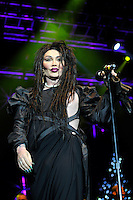 Pete Burns of Dead or Alive<br /> Performing at the PWL Hit Factory Live, o2 Arena, London, England, UK, <br /> 21st December 2012.<br /> music live on stage concert gig half length  black dress green contact lenses make-up pearl necklace shoulder pads cut out away dress microphone <br /> CAP/MAR<br /> &copy; Martin Harris/Capital Pictures /MediaPunch ***NORTH AND SOUTH AMERICAS ONLY*** /MediaPunch ***NORTH AND SOUTH AMERICAS ONLY***