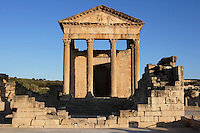 Low angle view of the front of the Roman Capitol, 2nd century, in Dougga, Tunisia, pictured on January 31, 2008, in the morning. Dougga has been occupied since the 2nd Millennium BC, well before the Phoenicians arrived in Tunisia. It was ruled by Carthage from the 4th century BC, then by Numidians, who called it Thugga and finally taken over by the Romans in the 2nd century. Situated in the north of Tunisia, the site became a UNESCO World Heritage Site in 1997. This is one of the best preserved Roman temples in North Africa with a portico of six Corinthian columns. Picture by Manuel Cohen.