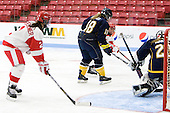 Jill Cardella's (BU - 22) shot gets past Kasey Martin (Windsor - 20) to make it 3-1 in the second period. - The Boston University Terriers defeated the visiting University of Windsor Lancers 4-1 in a Saturday afternoon, September 25, 2010, exhibition game at Walter Brown Arena in Boston, MA.
