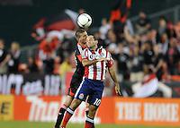 Chivas USA midfeilder Nick LaBrocca (10) heads the ball against D.C. United midfielder Perry Kitchen (23) D.C. United defeated Chivas USA 1-0 at RFK Stadium, Sunday September 23, 2012.