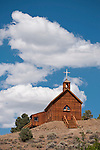 Wooden historic Catholic church on the hill, clouds (moved to Manhattan in the late 1800s from Belmont)