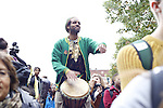 Lawrence Greene, founder of Ugata, plays African drums to bring cultural enrichment and celebration to the #HandsUpWalkOut Rally. Photo by Olivia Wallace