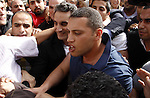 Egyptian artist Bassem Yousef walks out the High Court in Cairo on March 31, 2013. Bassem Youssef, the Arab world's 'Jon Stewart', had been issued an arrest warrant and compulsory summons by the prosecutor-general. The charges? 'Insulting Islam' and 'insulting the president'. Photo by Tareq Gabas
