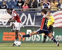 Chivas USA midfielder Shalrie Joseph (18) passes the ball under pressure. In a Major League Soccer (MLS) match, the New England Revolution tied Chivas USA, 3-3, at Gillette Stadium on August 29, 2012.